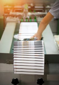 Stack of books hot off the press from InstantPublisher, the premier self-publishing book company