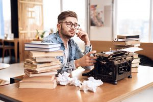 Man writing for a self-publishing book printing project